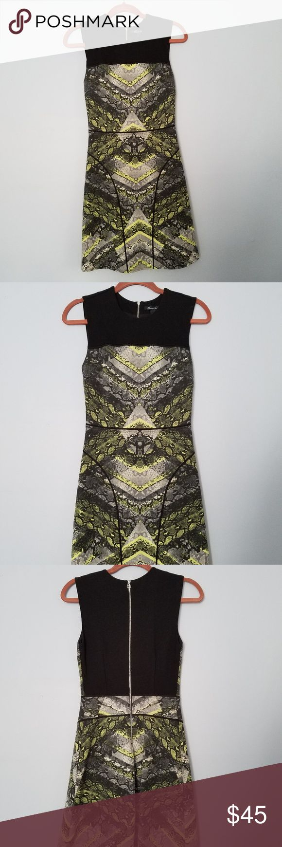 Kenneth Cole Snakeskin Dress MUST HAVE! Kenneth Cole New York in a mesmerizing print of chevron stripes layered over a black and neon yellow snakeskin pattern defines a sleeveless, fitted dress accented with solid black for the yoke, back bodice and piping trim. Exposed back-zip closure, side-seam pockets, lined. This dress is very true to size and, very comfortably, fits like a glove. Only worn twice and in EXCELLENT condition! Kenneth Cole Dresses