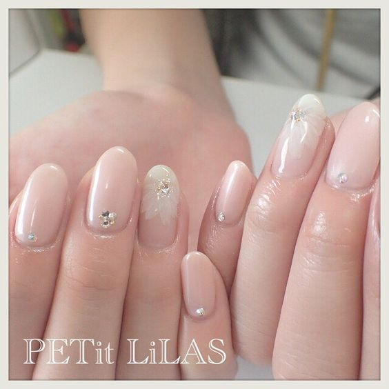 Pretty summer or spring nails. Delicate flower. Classic look. Nude shades
