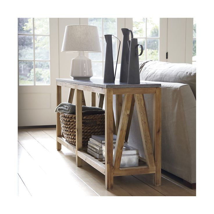 Shop Bluestone Console Table.   Each unique table base is handcrafted of pine reclaimed from abandoned buildings, referencing traditional farmhouse construction with angled struts and a slatted lower shelf.