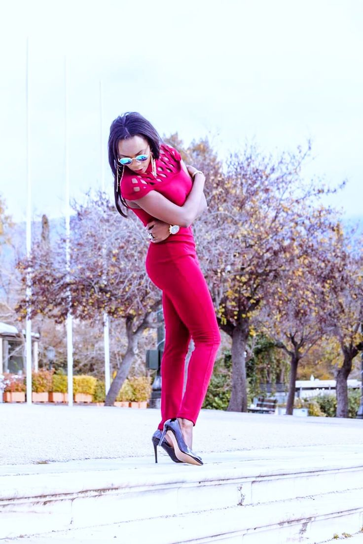 Red Jumpsuit with black heels dope