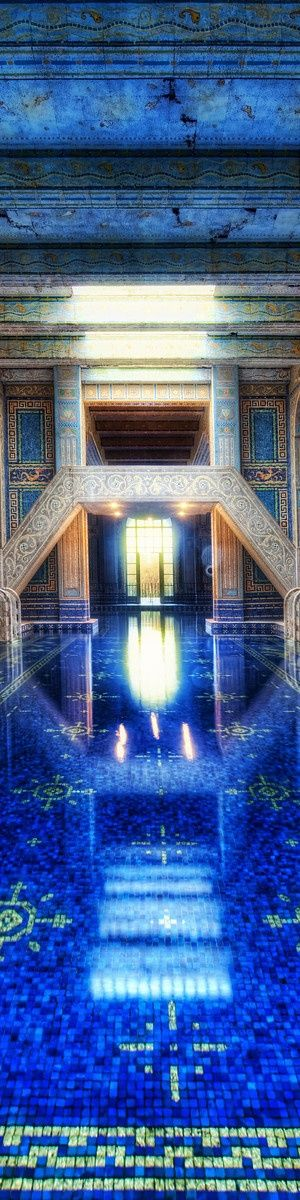 The Roman Pool at Hearst Castle, San Simeon, CA - The Roman Pool is decorated from ceiling to floor with 1″ square mosaic tiles. These glass tiles, called smalti, are either colored (mainly blue or orange) or are clear with fused gold inside.