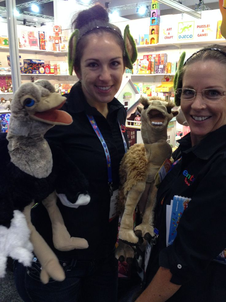 Elf Bec with the #Folkmanis Ostrich Puppet and our Chief Poohbah with the #Folkmanis' Camel - so much detail! #toyfair