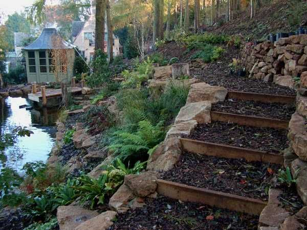Wooden outdoor stairs and landscaping steps on slope for Natural garden designs