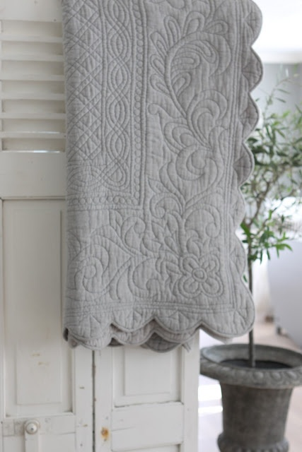 Lovely intricately quilted blanket.