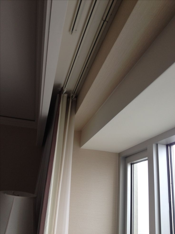 Curtain tracks hidden behind ceiling molding