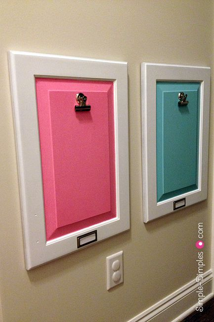 Love this idea for painting old cabinet doors and using them as a backdrop for displaying kid's artwork.