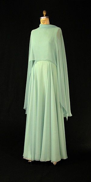 First Lady Betty Ford's green chiffon gown with cape by Albert Capraro. A matching chiffon scarf is also included with this sleeveless dress