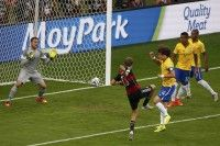 Germany's Thomas Mueller scores a goal against Brazil during their 2014 World Cup semi-finals at the Mineirao stadium in Belo Horizonte
