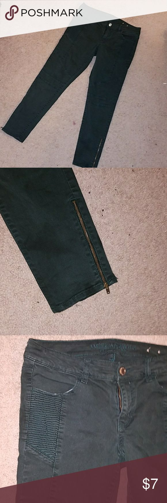 Dark green American Eagle Jeans Very dark green American Eagle Outfitters size 10 jeans.  There is ribbed detailing on the hips and zipper details at the bottom of the legs on the side. American Eagle Outfitters Pants Skinny
