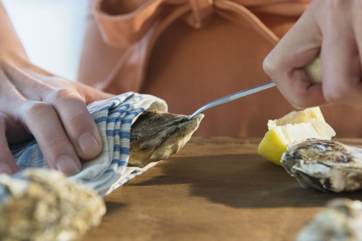 Here's how to shuck oysters like a pro with easy step by step instructions. Enjoy your fresh oysters on the half shell, or with a luxurious topping.