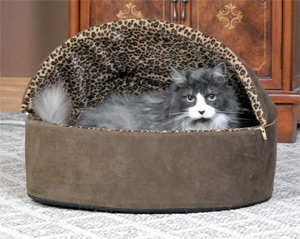 Thermo-Kitty Deluxe Leopard Heated Cat Bed - The Leopard Thermo-Kitty Bed has a dual thermostat, 4 watt heating unit buried within its thick premium polyfil pillow base. It warms the surface 10-15 degrees above ambient air temperature when not in use. When your pet lies in the bed it warms to your pet's normal body temperature to keep them cozy warm. Visit http://www.petstreetmall.com/heated-cat-beds/373.html for more...