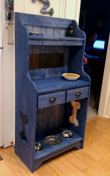 Cool feeding station for my animals... cats on the top & puppies on the bottom.