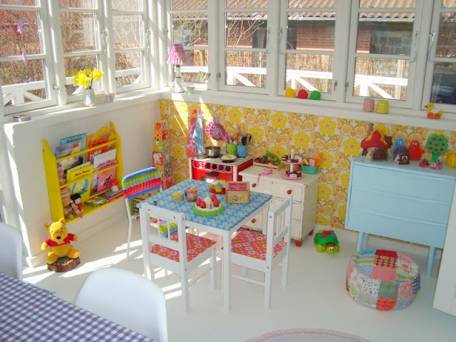 Colourful kids corner. Retro kids corner. Retro yellow wallpaper. Wallpaper on furnitures. old dresser. Pastel colourson textile.