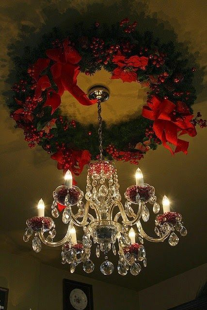 Great idea - a wreath above the chandelier - like a beautiful Christmas ceiling medallion! I like keeping the chandelier decorations simple.