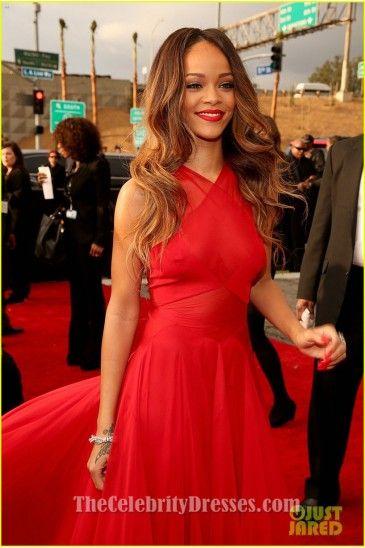 Rihanna in a long red dress
