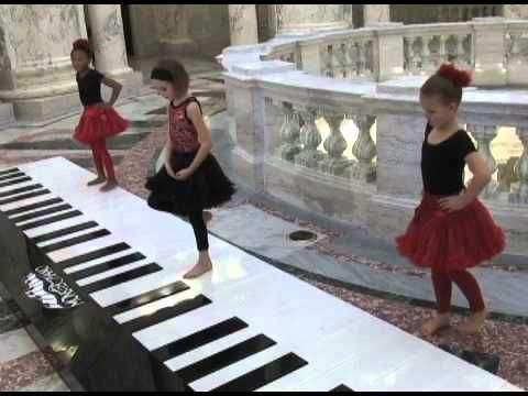 ▶ Monster Piano Carol of the Bells - YouTube.  3 little girls perform with their feet.