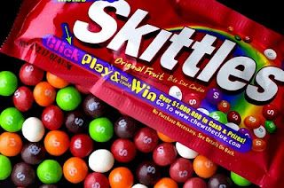 Skittle game for primary singing time.We take a bag of Skittles and I draw names and the child comes to the front of the room. They close their eyes and put a skittle in their mouth and try to guess the color. If they get it right then the get to pick a song, but if it's wrong then it's my choice.