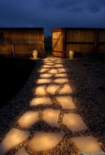 """Pathway of rocks painted with glow in the dark paint (Rust-Olem Glow in the Dark Brush-on Paint). During the day they """"charge"""" in the sun and in the evening they reflect stored light! How cool! - Click image to find more Home Decor Pinterest pins"""