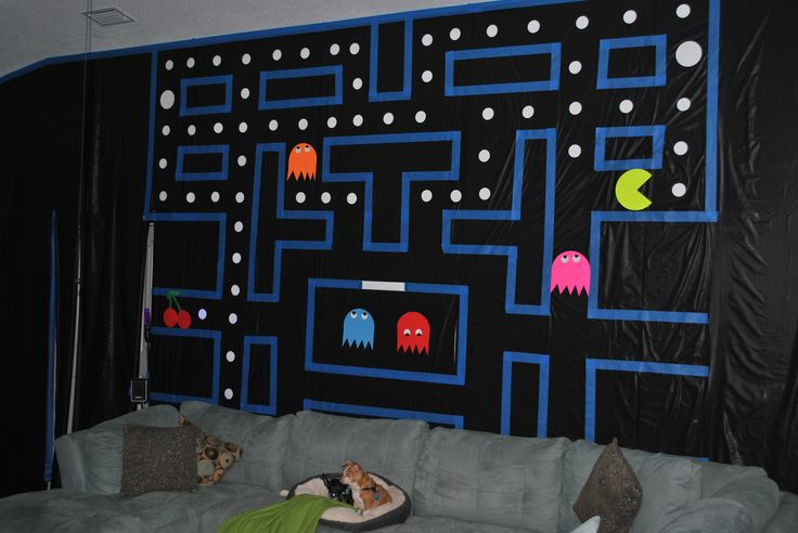 80s party decor Pac-Man wall  ----Used one roll of black plastic table cloth material (party store), thick blue painter's tape for the lines and cut out card stock for the dots, ghosts and Pac-Man.  The puppies were very confused.  LOL