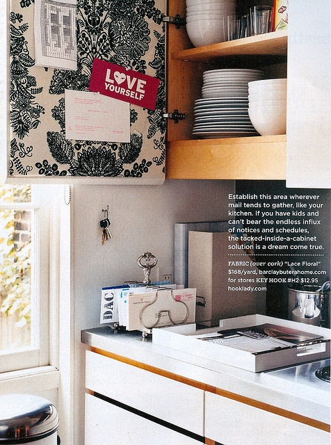 fabric covered cork board inside cabinet- genius! Hide the clutter and actually put the inside of the doors to use!