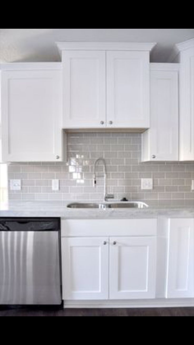 47 best home images on pinterest gray living rooms kitchen and smoke gray glass subway tile white shaker cabinets pull down faucet gorgeous contemporary kitchen like the grey glass subway tile for back splash dailygadgetfo Gallery
