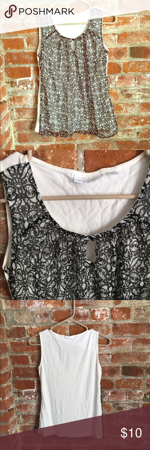 Black & white Cami top New York & company black and white Cami. Perfect for under a blazer or sweater. Decorative front and solid white back size small. Wore only once New York & Company Tops Camisoles