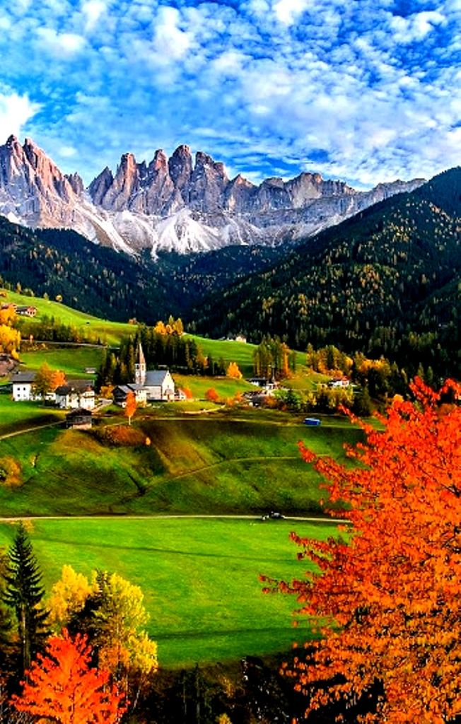 The Odle mountain peaks and the church of Santa Maddalena, Trentino Alto Adige in northern Italy.