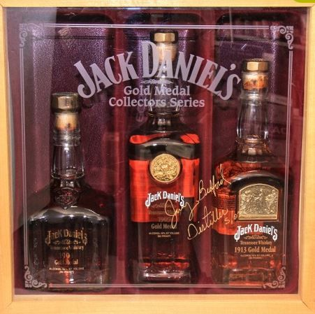 Jack Daniels Gold Medal series.    It contains the following 3 Jack Daniels Gold Medal Bottles:   •1904 St. Louis World's Fair Gold Medal 45% ABV 750 Ml   •1905 First international gold medal won by Jack Daniels in Liege, Belgium 45% ABV 750mL   •1913 Lem Motlow entered Jack Daniel's Whiskey and won this gold medal in Ghent, Belgium. 45% ABV 750mL   The Jack Daniels Gold Medal Collection Box has been signed with a gold sharpie on the front perspex window by Jimmy Bedford in May 2002.