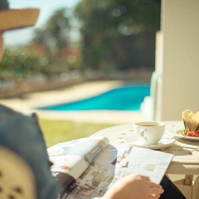 Breakfast snacks with your morning coffee are best enjoyed in the garden whilst reading a local magazine or your favourite book.   ________  #TheLastWordLongBeach #CapeTown #travelphotography