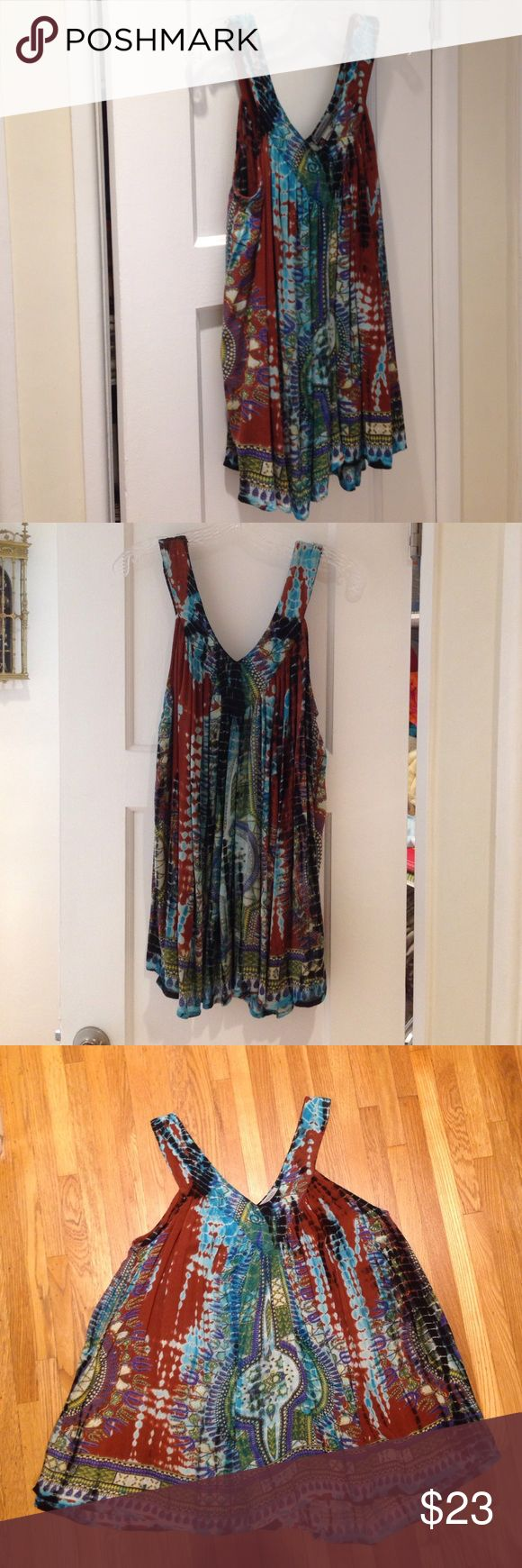 Bohemian Flow Tank Style Woman's Top This World Market bohemian flowy tank style blouse/top has a combined tie dye and Indian pattern that gives it an ethnic look. The flowy style of this top is great for 😉 camouflaging love handles, muffin tops, and or just simply being super comfortable. It's made of 100% rayon, size L/XL. Multicolored in brown, teal, turquoise, green, blue, yellow, black and ivory. World Market Tops Tank Tops
