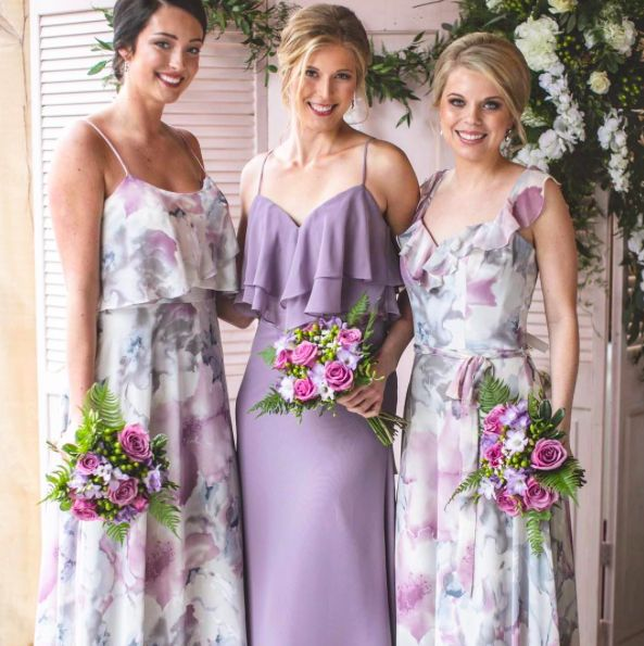 Lavender and Purple Floral Flounced Mix and Match Bridesmaid Dresses by Morilee | Madeline Gardner. Long Chiffon Styles. Photo by Alisha Sims.