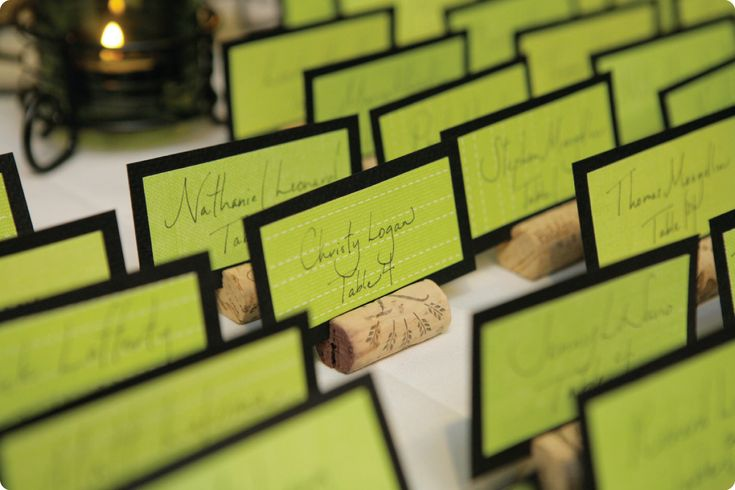 name cards for wedding reception | Green and black name cards were inserted into cut wine corks, cut by ...