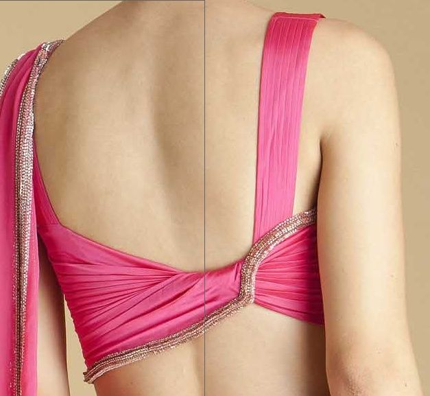 Pink blouse with twisted design pattern at back of blouse. (via MinMit)