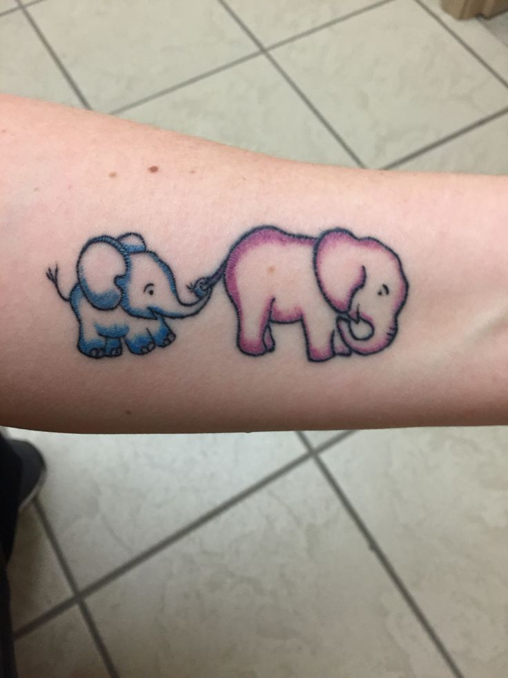 Two weeks healed mother son elephant tattoo.