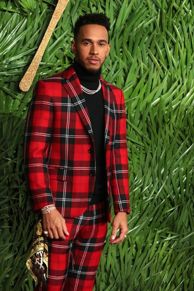 Lewis Hamilton Photos - British F1 driver, Lewis Hamilton poses on the red carpet upon arrival to attend the British Fashion Awards 2017 in London on December 4, 2017..The prestigious awards, presented at the iconic Royal Albert Hall, were marked by a moving tribute to the great French-Tunisian designer Azzedine Alaia, who died last month at the age of 77.  / AFP PHOTO / Daniel LEAL-OLIVAS - Lewis Hamilton Photos - 1 of 30071