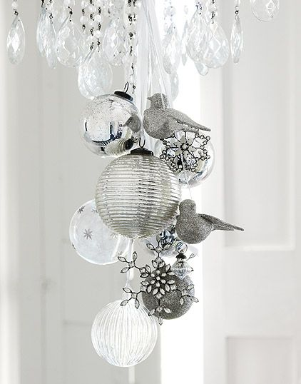 white and silver ornaments hung from a crystal chandelier
