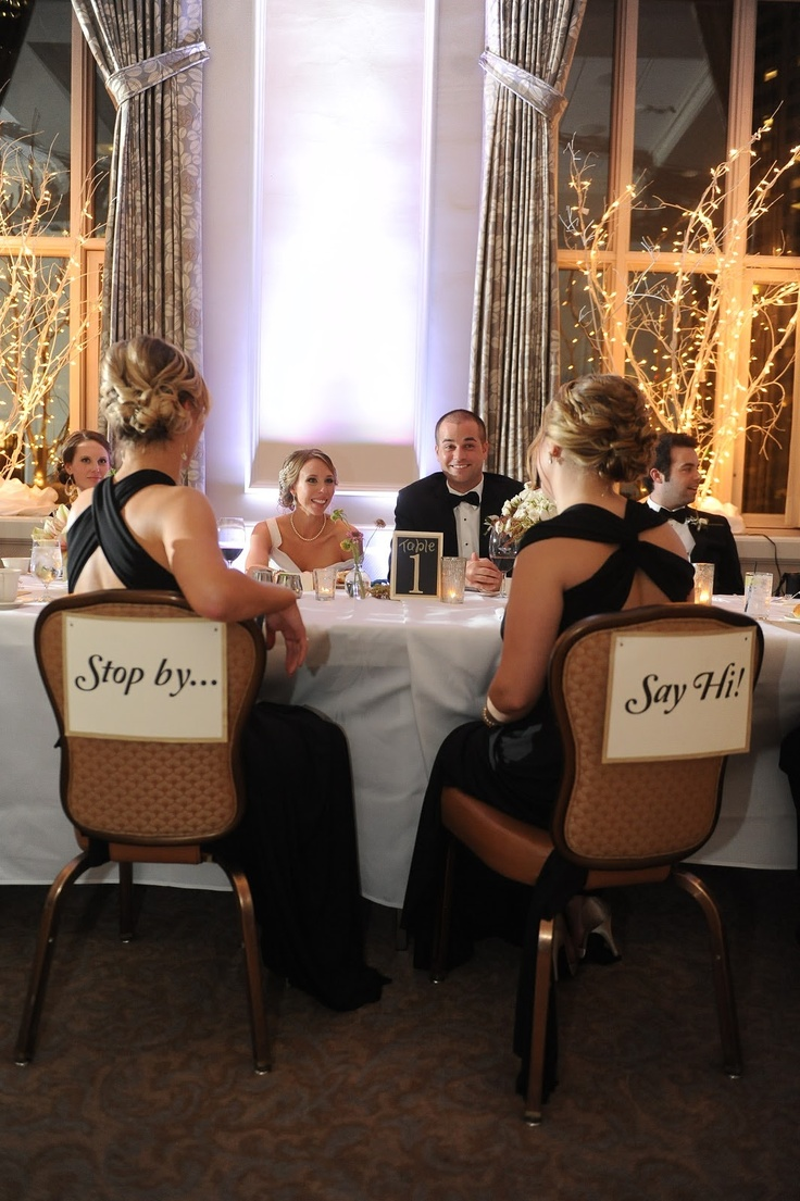 Having empty chairs across from the bride and groom is a Scandinavian tradition. The signs aren't necessary, guest just know that they are invited to come and chat.     This is a simple way to take the pressure off of the bride and groom to do a receiving line or make it around to every table to greet everyone. This way the newlyweds can actually sit and enjoy the meal and it's up to the guests to say hello...What a great idea!