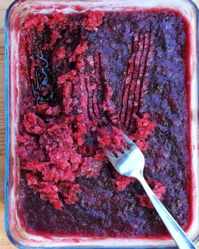 Raspberry & Red Wine Granita, an icy-cold raspberry slushee for grown-ups. Just three ingredients, no ice cream maker, just a freezer and a fork. For Weight Watchers, just #PP3.