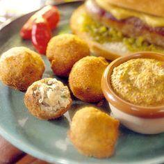 Sauerkraut Balls: A traditional German appetizer. Sweet-sour tang of mustard + kraut inside deep-fried shells.