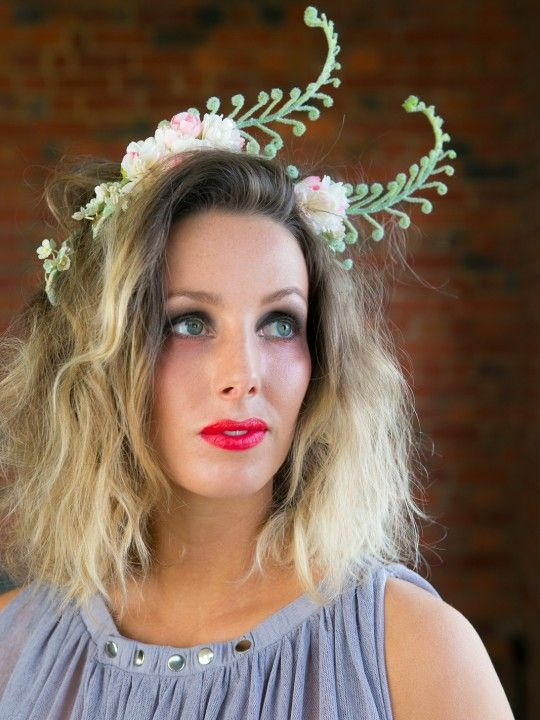 TITANIA | Fascinator Bridal/Spring Racing Carnival | FORD MILLINERY  $295  Whimsical, majestic and of Goddess bloodline, Titania is a delicate finish to add feminine touch. Faux cherry-blossoms intertwine furry ferns, with the occasional peep of baby blue & lemon paper daisies. A curly fern sits to the side, all atop a reliable black ropey headband. Absolutely off with the fairies!