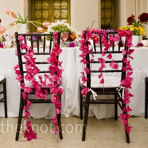 Long strands or origami to decorate bride and groom chairs at reception.