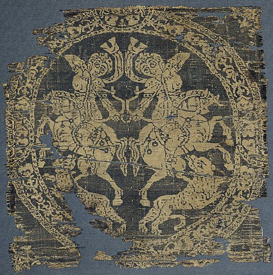 Roundel with Amazons  Date: 7th–9th century (?) Geography: Made in, Egypt or Syria (?) Medium: Weft-faced compound twill ( samit ) in blue-violet and beige silk Dimensions: Overall: 8 1/16 x 8 1/16 in. (20.5 x 20.5 cm):