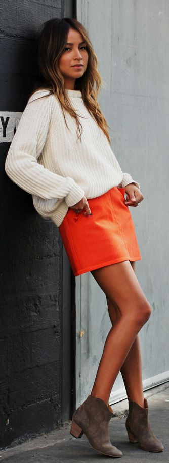 Orange Outfits: Julie Sarinana is wearing an orange mini skirt from Rag & Bone