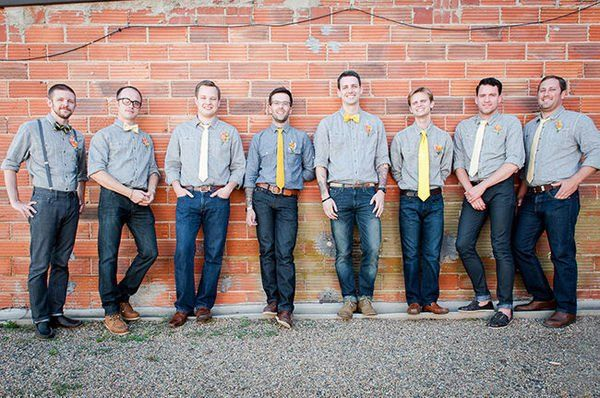 groom and groomsmen in blue jeans for casual wedding