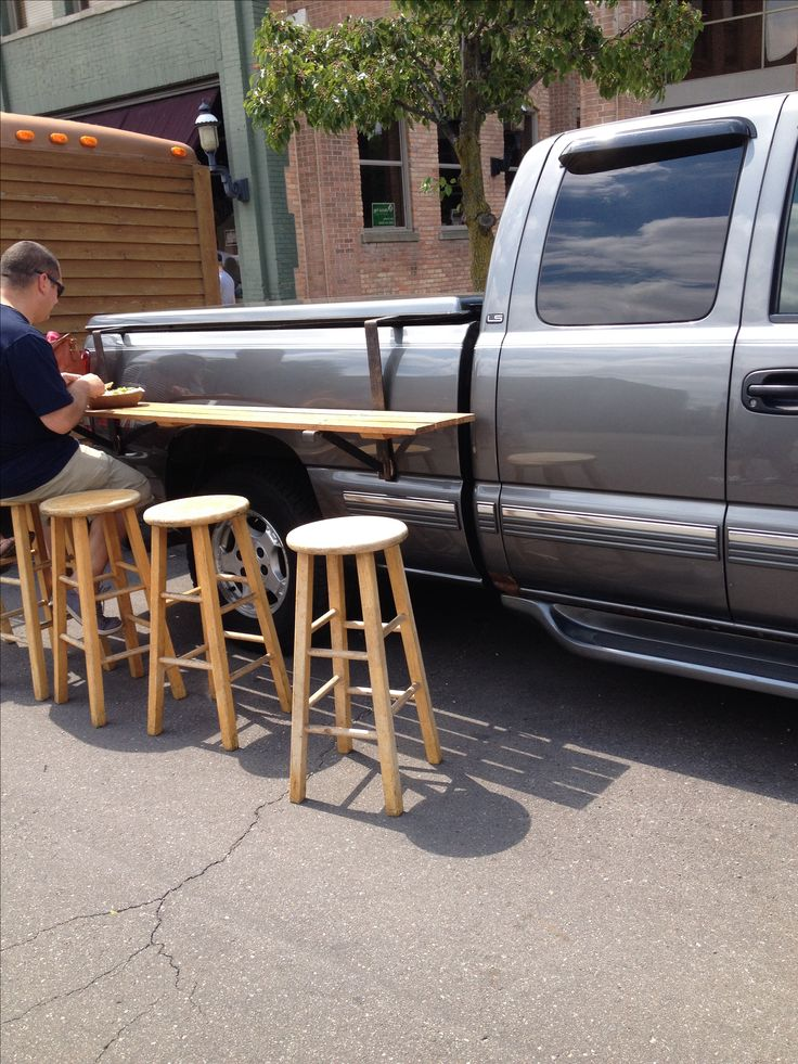 Truck bed picnic table. Make from aluminum tubing to make it lighter, and use aluminum folding stools. Great for tailgating or camping!