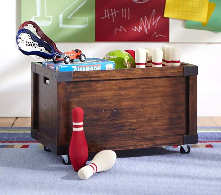 Idea for Henleys toy box!  on casters so its easy to move around. Rustic Toy Box | Pottery Barn Kids