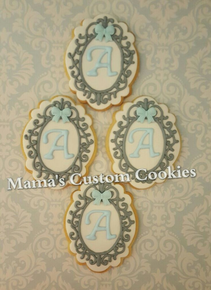 Custom framed initial cookies.  These are beautiful favors for a baby naming, baby shower, christening, birthday, etc. Contact Mama today to discuss your custom cookie needs. Never a minimum order required and we ship anywhere in the USA.  #frame #frames #initial #custom #babyshower #babygirl #babyboy #babyshowerfavors #babynaming #christening #christeningfavors #birthday #birthdayfavor #birthdayfavors #customframe #customframes #customcookies #mamascustomcookies