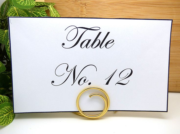 Gold Table Number Holders, Number Place Card Stands, Set of 6, Wedding Guest Table Decorations, Circle Table Number Stand by SimpleGem on Etsy https://www.etsy.com/listing/220695108/gold-table-number-holders-number-place
