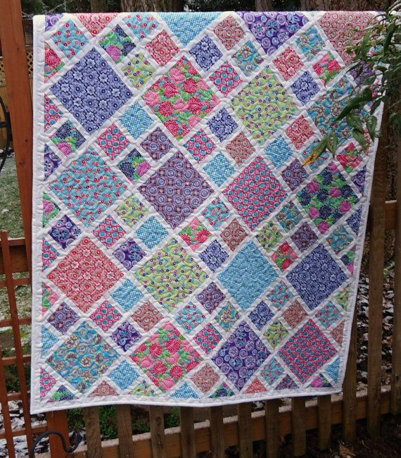 Fun design that could showcase prints in the larger square.  This link goes to an Etsy shop that sold this quilt.  Pattern would be easy to replicate.