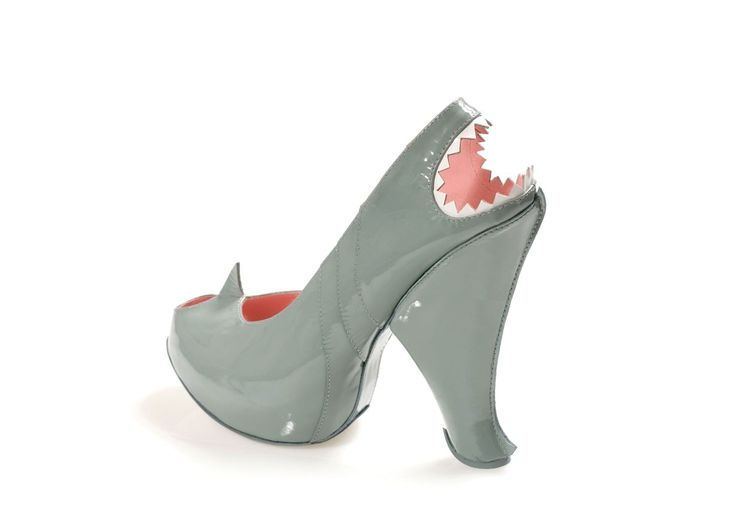 I love a good animal print...but would you wear animal shaped shoes? think these are fun!  ~Kobi Levi's Shark Shoe